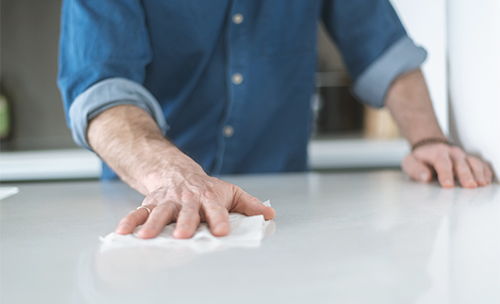 Cleaning counter with disinfecting wipe